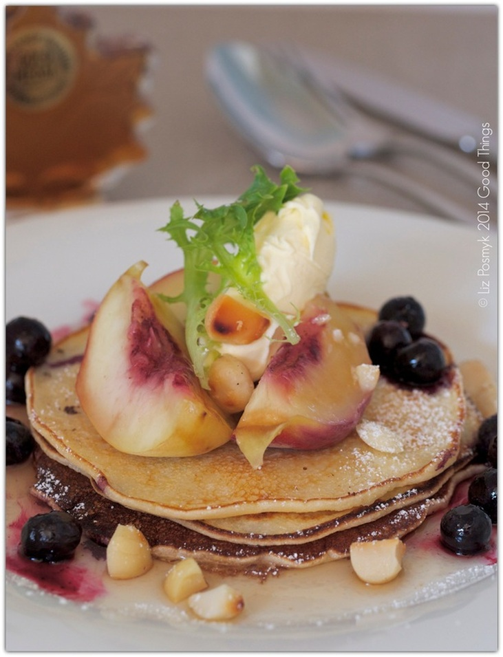 Peach and blueberry hotcakes with macadamias, mascarpone and maple syrup