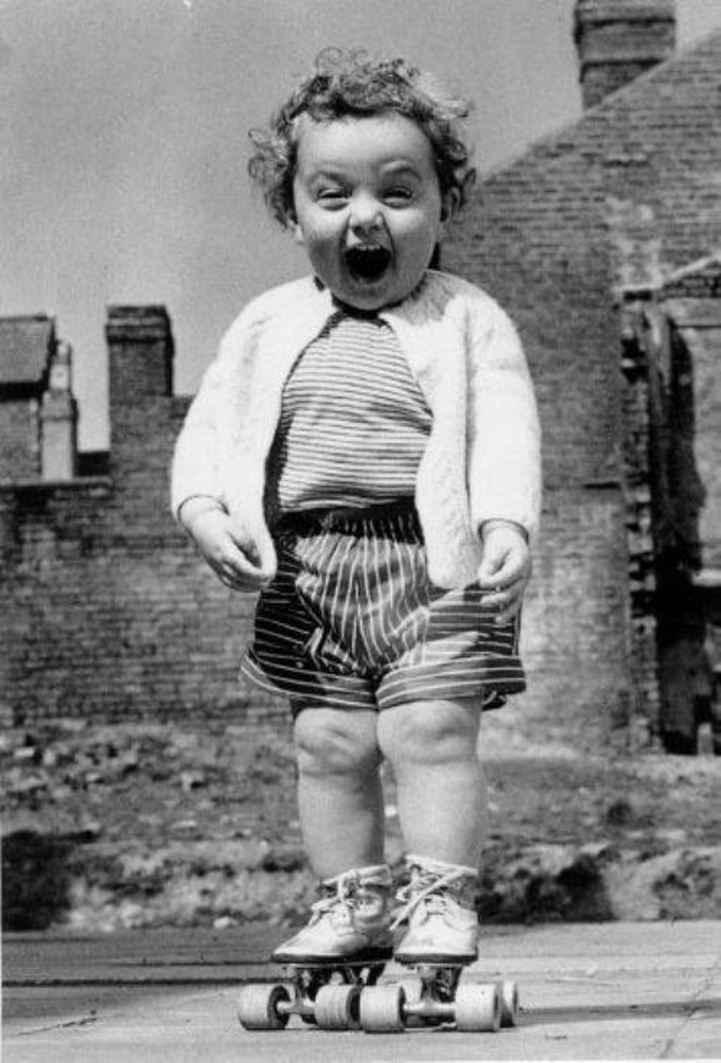 Vintage photograph of little girl on roller skates