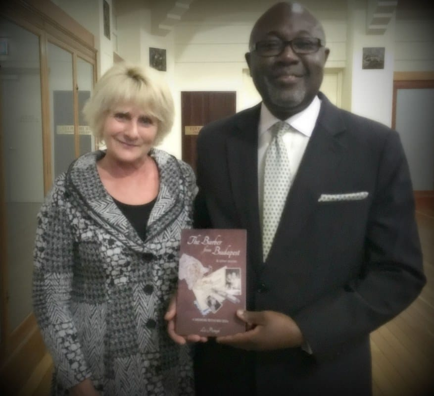 Author, Liz Posmyk, presents a copy of her book to Mr Joseph S. Appiah, Chief of Mission/Australia, Coordinator and Advisor for NZ PNG and the Pacific, IOM Canberra