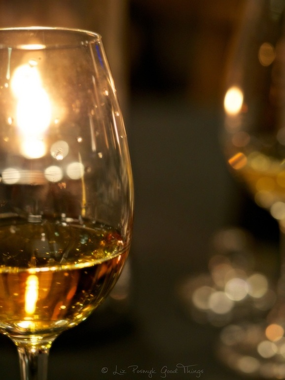 Whisky in glass by candlelight by Liz Posmyk Good Things