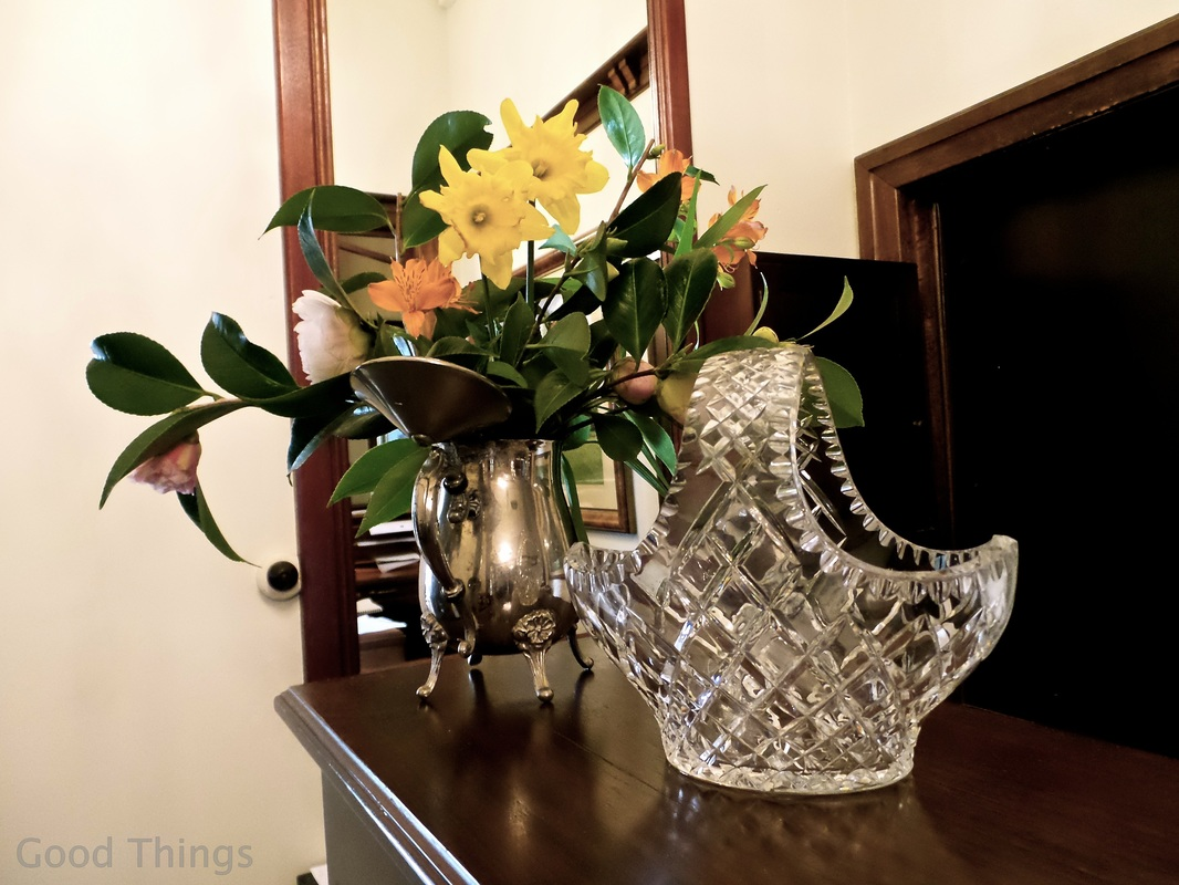 Fresh flowers and crystal on the sideboard in the reception area at The Robertson Hotel