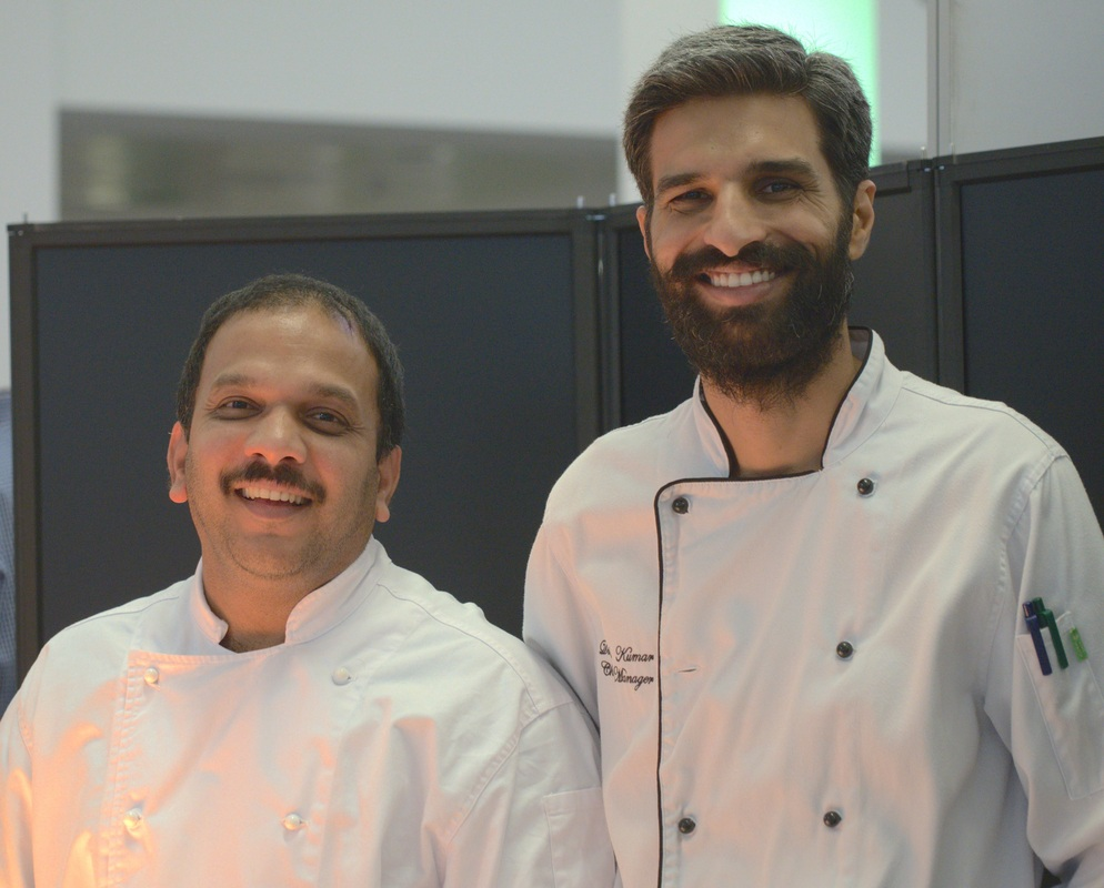 Chef Dinesh Kumar (right) and his assistant