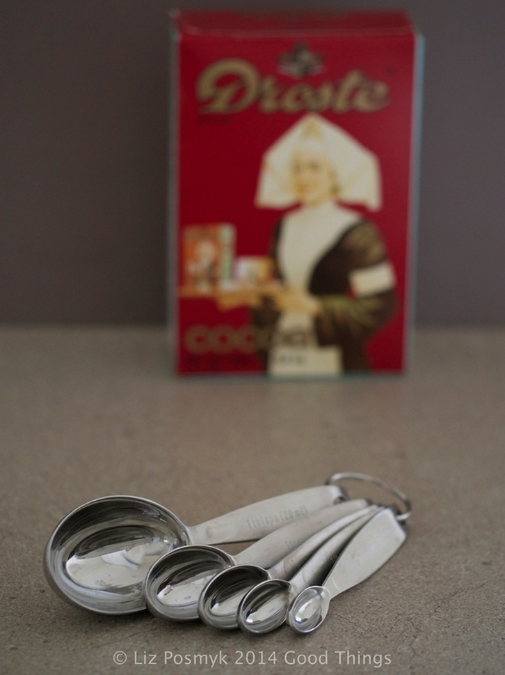 Measuring spoons and Droste cocoa by Liz Posmyk