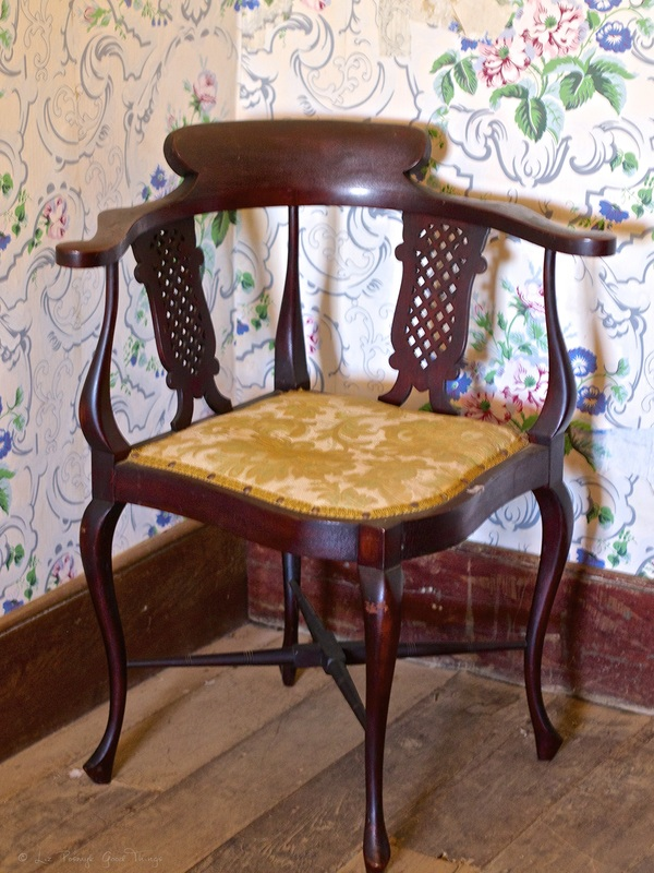 Walnut chair against wallpaper
