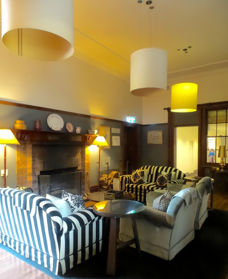 Sit by the fire in one of the lounge rooms at Peppers Manor House - photo Liz Posmyk Good Things