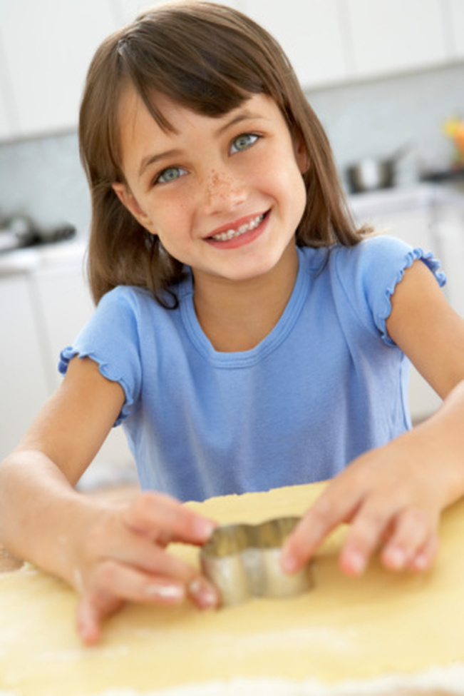 Fun in the kitchen with play dough and cookie cutters - stock photo