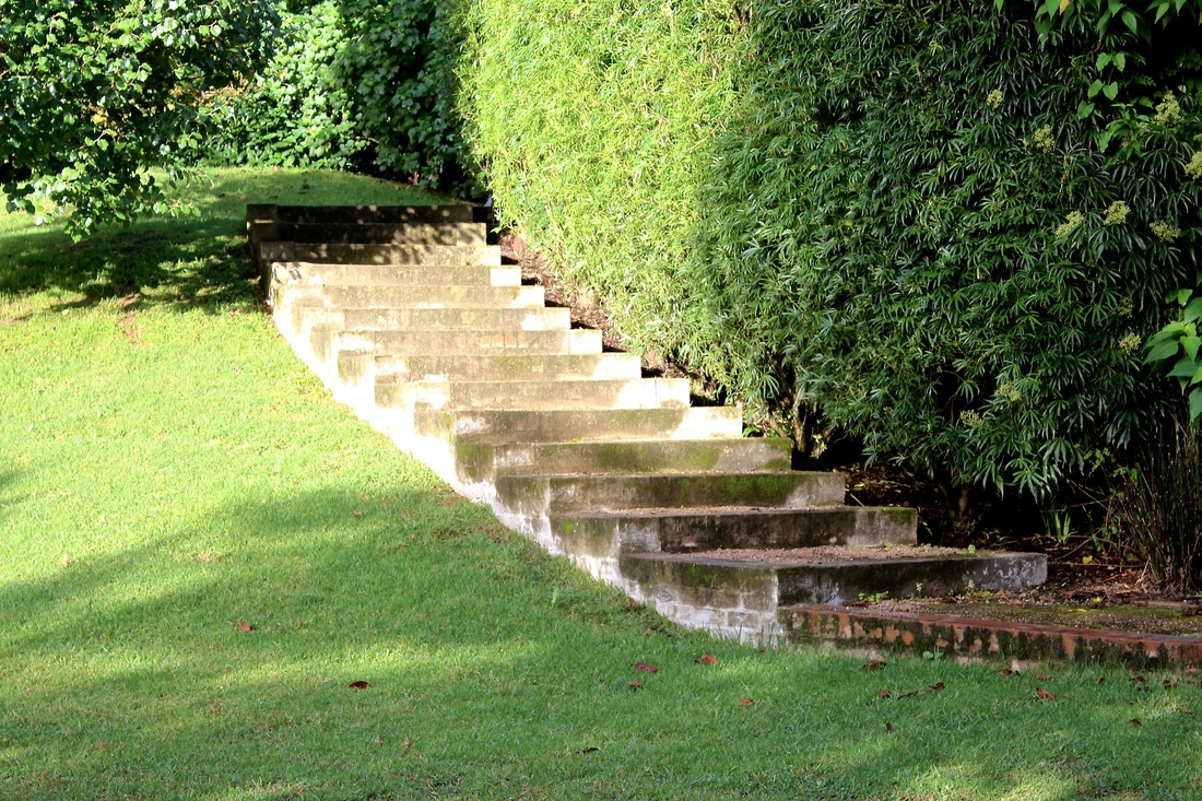 Steps lead from one level of the lawns to another at Sahali in the Kangaroo Valley NSW