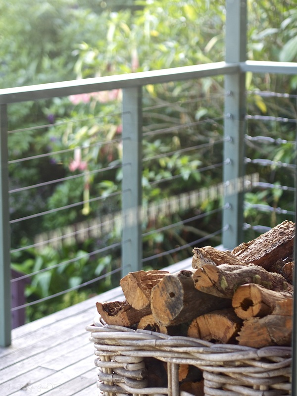 Basket of wood on the deck at Sahali in the Kangaroo Valley NSW