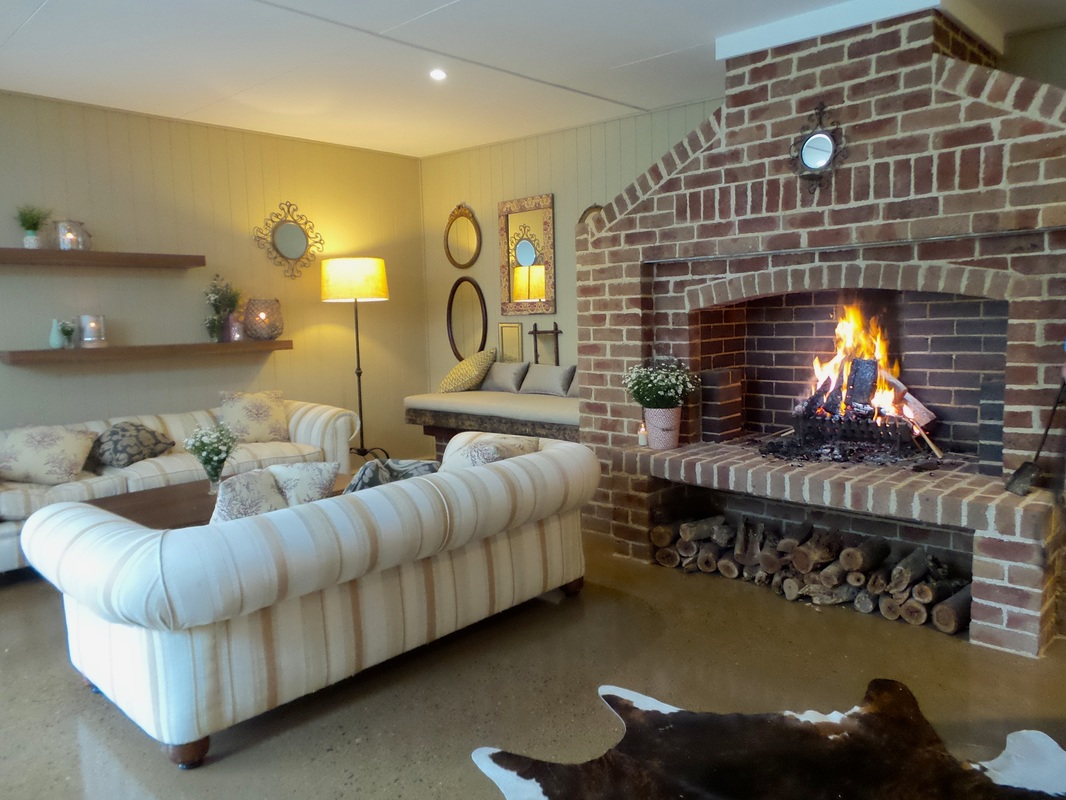 The fireplace and lounges in the all weather event space at Peppers Manor House