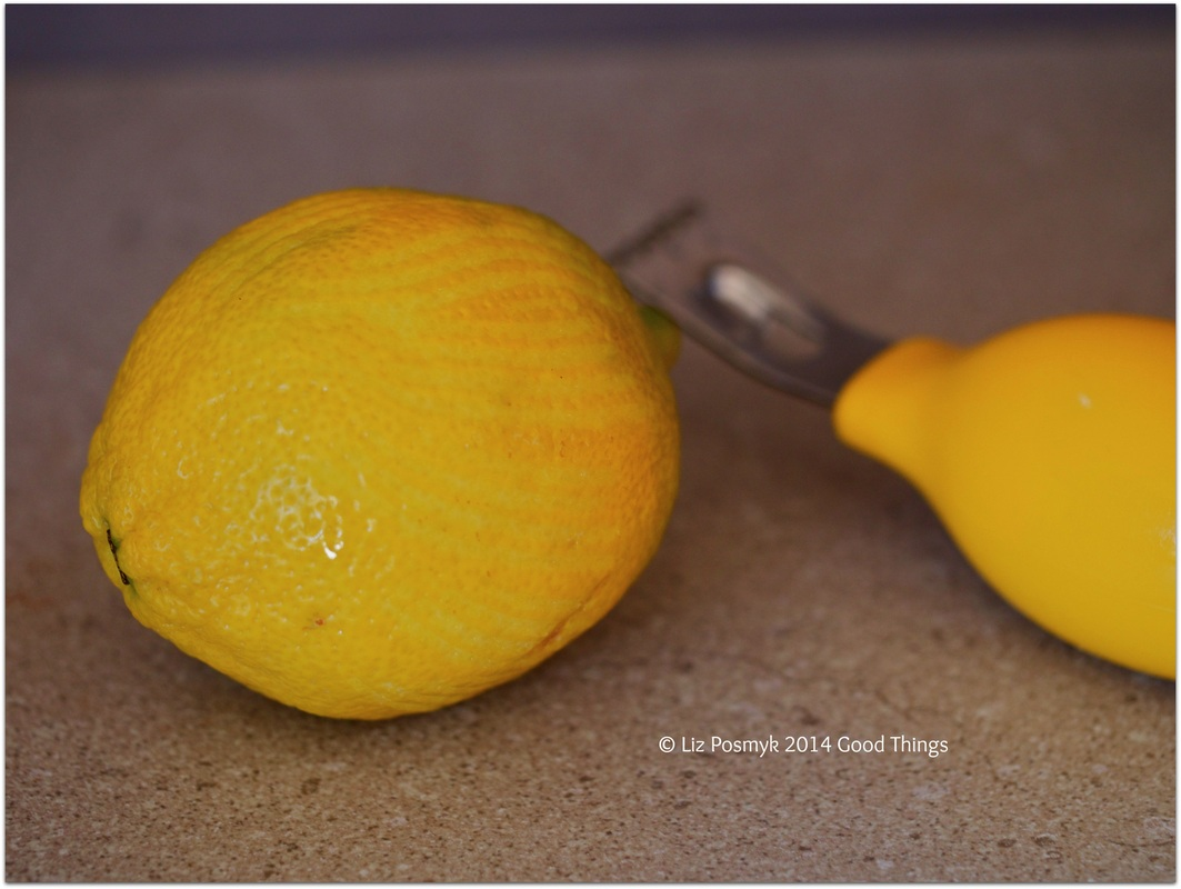 Zesting lemon by Liz Posmyk