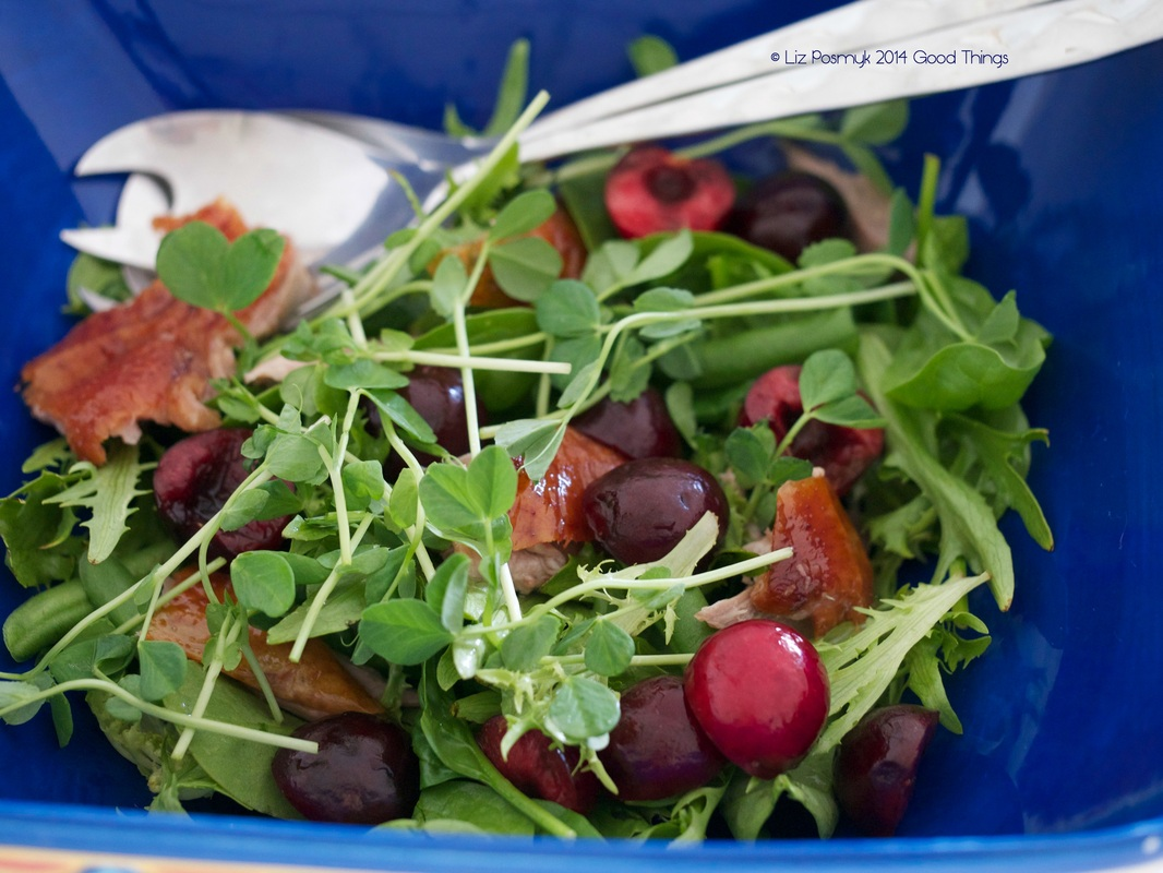 Fresh cherries with salad greens and roasted duck