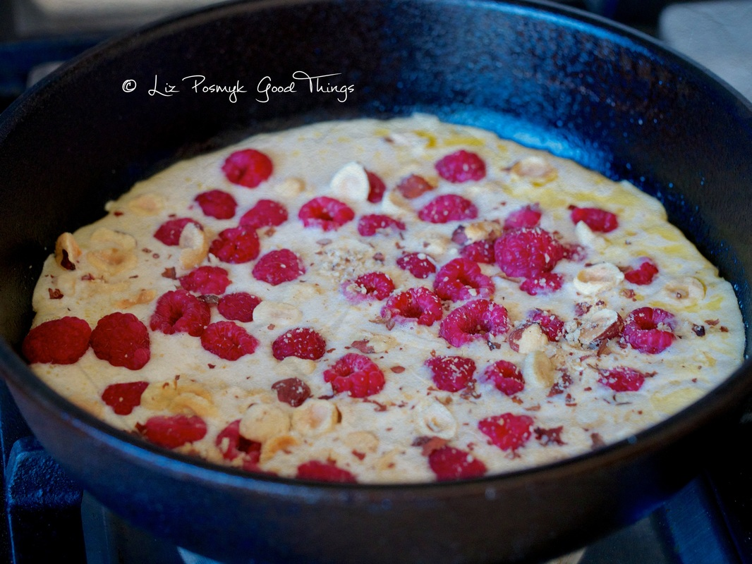 Before baking - Raspberry Dutch baby pancake with vanilla and hazelnuts