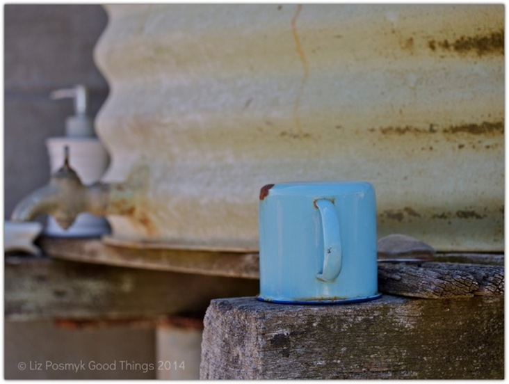 Old enamel cup and water tank at Wapengo Rocks by Liz Posmyk Good Things