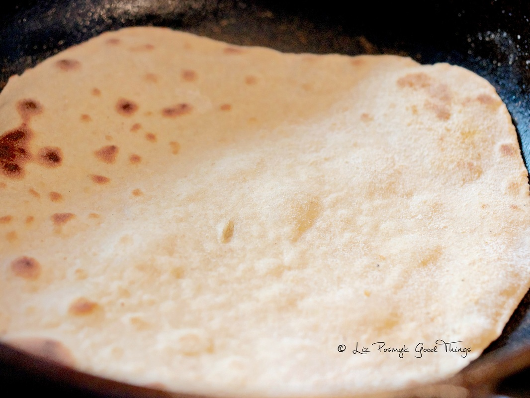 Brown the chapatis slightly, then turn it over
