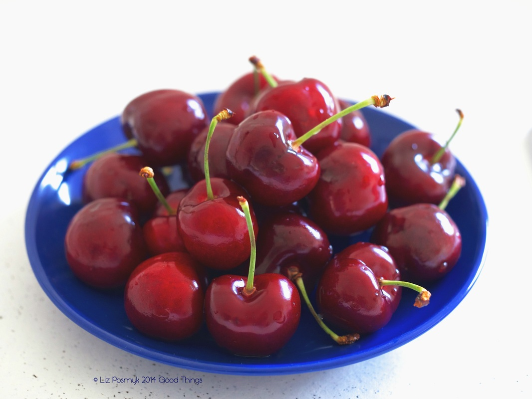 Bowl of cherries on blue by Good Things
