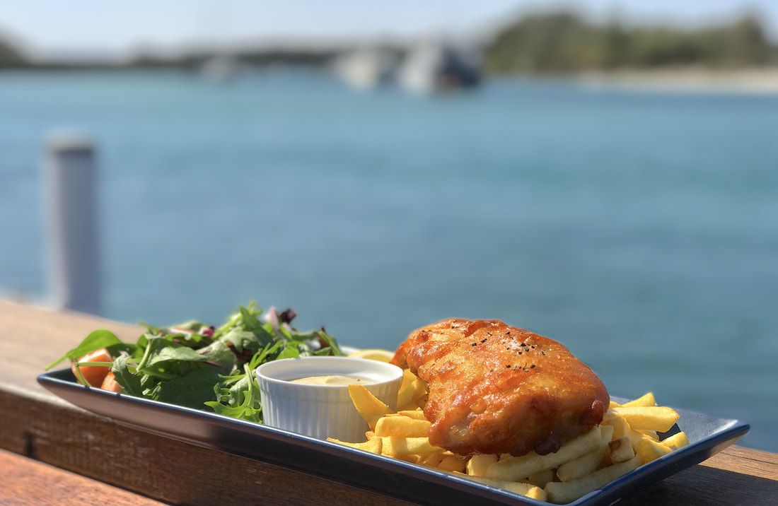Fish and chips with salad at Portside Cafe on the waterfront at Huskisson - Liz Posmyk
