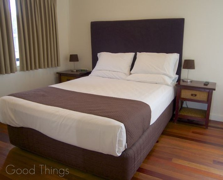Master bedroom in the Deluxe Spa Cabin at Discovery Holiday Parks Gerroa - Liz Posmyk Good Things