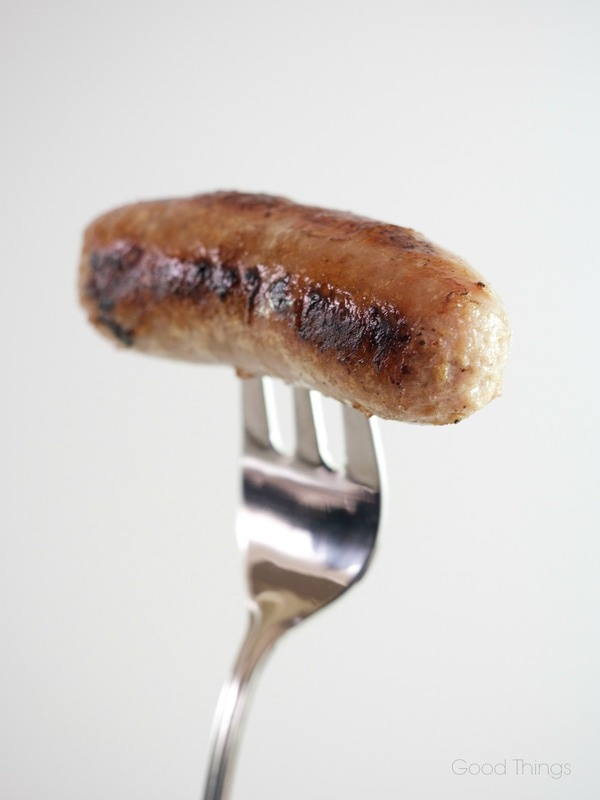 Pork chipolata sausage on a fork by Liz Posmyk Good Things