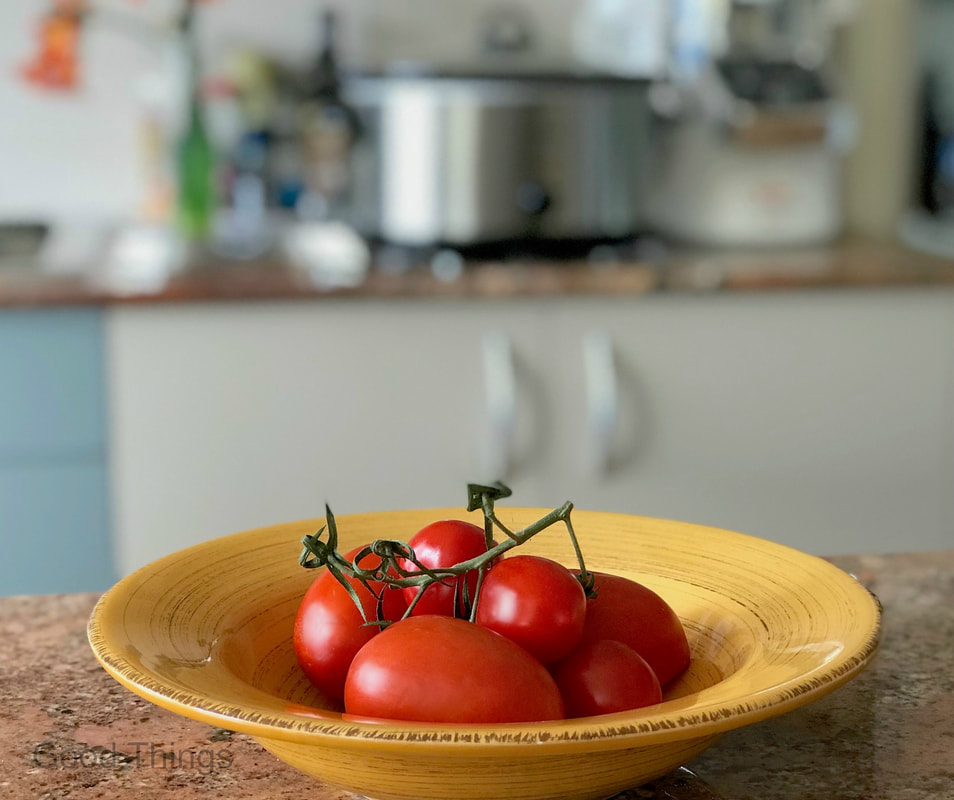 Ripe tomatoes in a bright yellow bowl  - Liz Posmyk Good Things